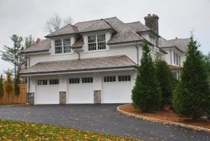 Colonial spec house with 3 car garage by DeMotte Architects in CT