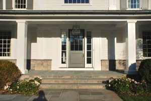 Colonial spec house with porch by DeMotte Architects
