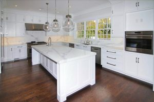Contemporary kitchen in Colonial spec house in CT by DeMotte Architects