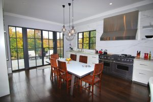 Georgian Colonial kitchen with steel doors and natural light in CT
