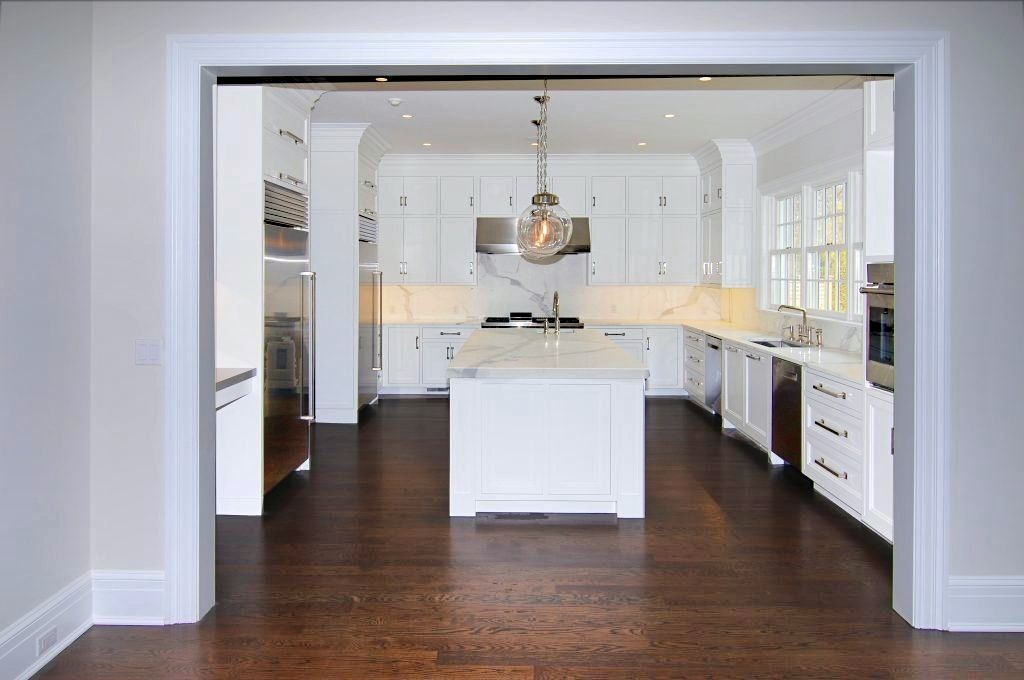 Kitchen in Colonial spec house in Greenwich CT by DeMotte Architects