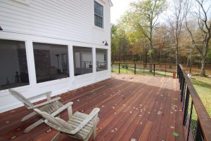 Mahogany deck with stainless steel cable rail system in NY