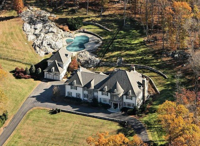 aerial view French country home exterior in katonah ny by ct & ny architect demotte architects