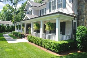 Colonial home with cedar shingles and front porch in NY