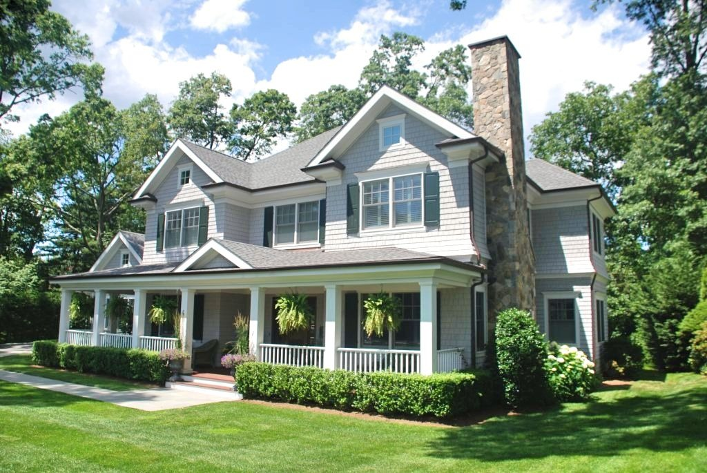Colonial home with front porch home design by DeMotte Architects