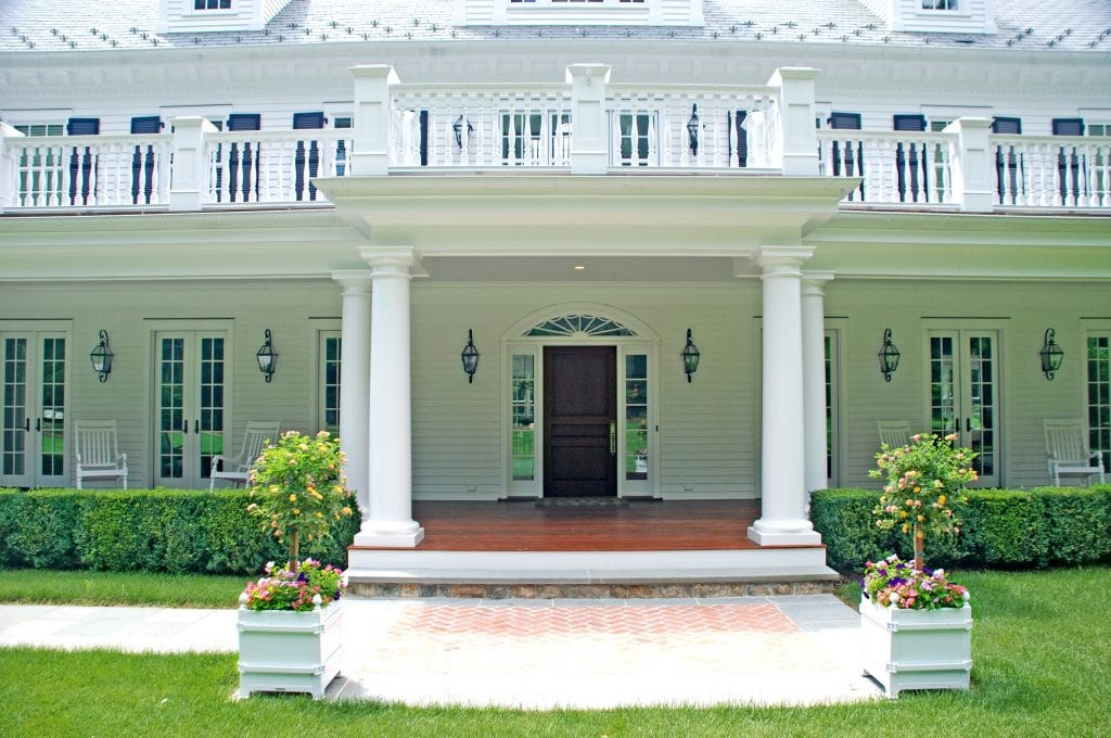 Colonial home with porch in Fairfield County CT by DeMotte Architects