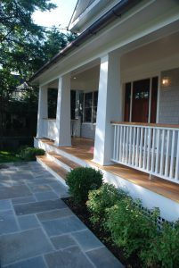 covered porch of shingle style home in rye ny by demotte architects