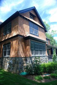 large windows in shingle style home in rye ny by demotte architects