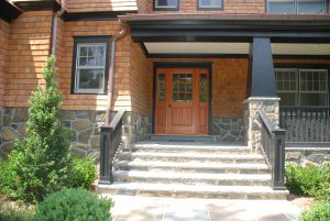 front door of shingle style home in rye ny by demotte architects
