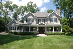 colonial home with porch by demotte architects