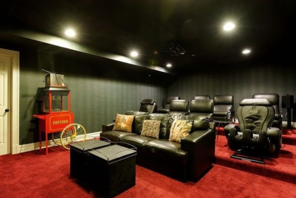 Home theater in shingle style home by DeMotte Architects