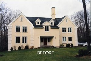 Home with stucco detailing that was remodeled in NY
