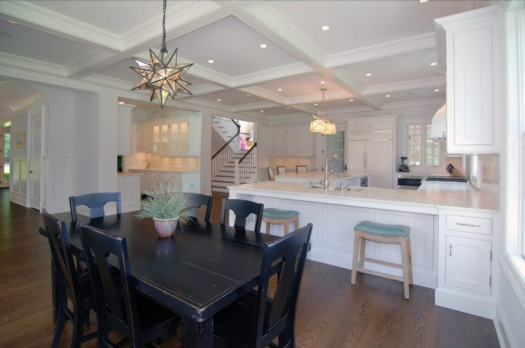 Kitchen and dining area in Westport CT home by DeMotte Architects