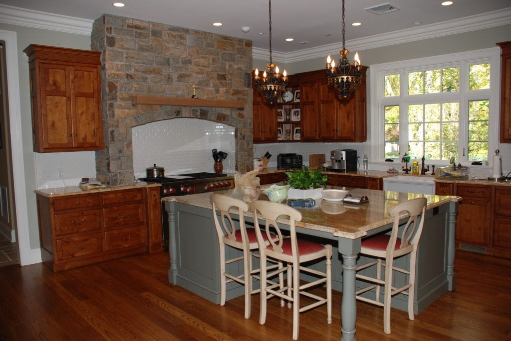 Kitchen in shingle style home in NY by DeMotte Architects