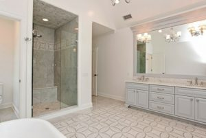 Master bathroom in Rye NY Colonial home by DeMotte Architects