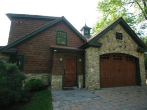 New Fairfield CT shingle style home with carriage style garage doors