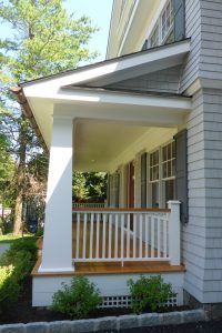 front porch of rye ny shingle style home by demotte architects