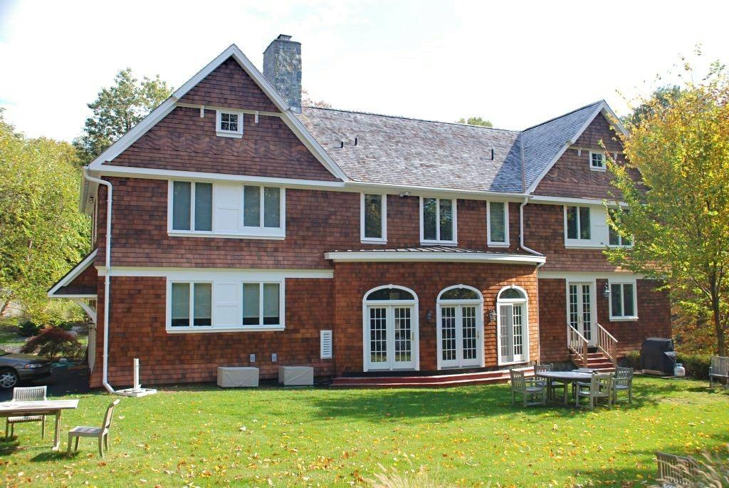 Pound Ridge NY shingle style home by DeMotte Architects rear shown
