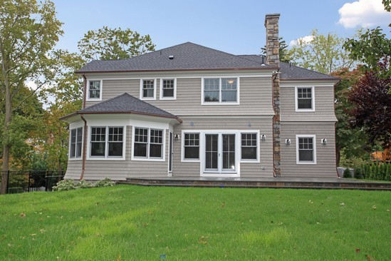 Rear View shingle style home rye ny