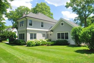 Rye NY Colonial home with shingles rear shown