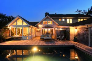 Rye NY home addition and remodel by DeMotte Architects shingle style home with rear deck