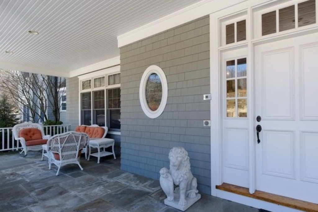 Shingle style home entrance in Purchase NY by DeMotte Architects