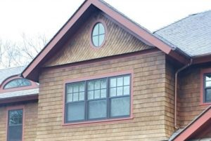 Shingle style home with aluminum clad windows finished in bronze color
