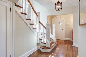 Tudor home interior with arched door in Rye NY