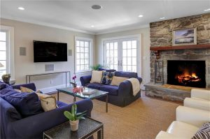 Tudor home remodel in NY by DeMotte Architects living room shown