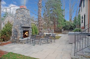 Tudor home remodel with outdoor fireplace in Rye NY