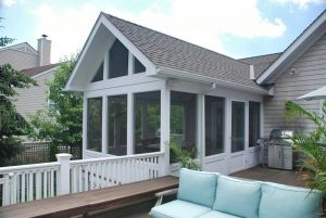 Westchester County remodel and addition by DeMotte Architects screened porch shown