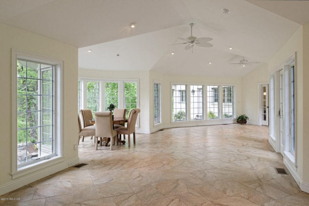 Beautiful sunlit hall in custom home by DeMotte Architects