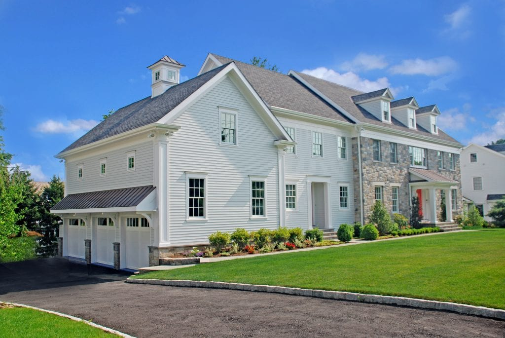 Colonial home with 3 car garage in Westchester County NY by DeMotte Architects