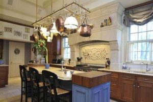 Country style kitchen in Rye NY after addition by DeMotte Architects