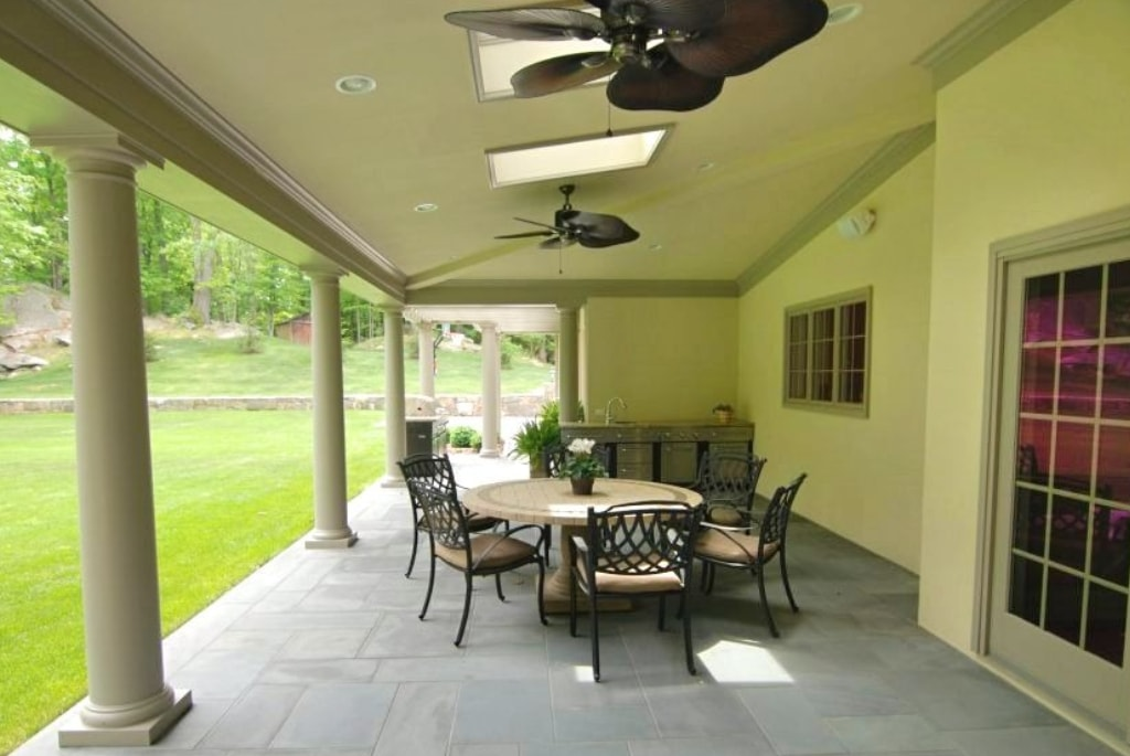 Covered terrace with ceiling fans in CT custom home