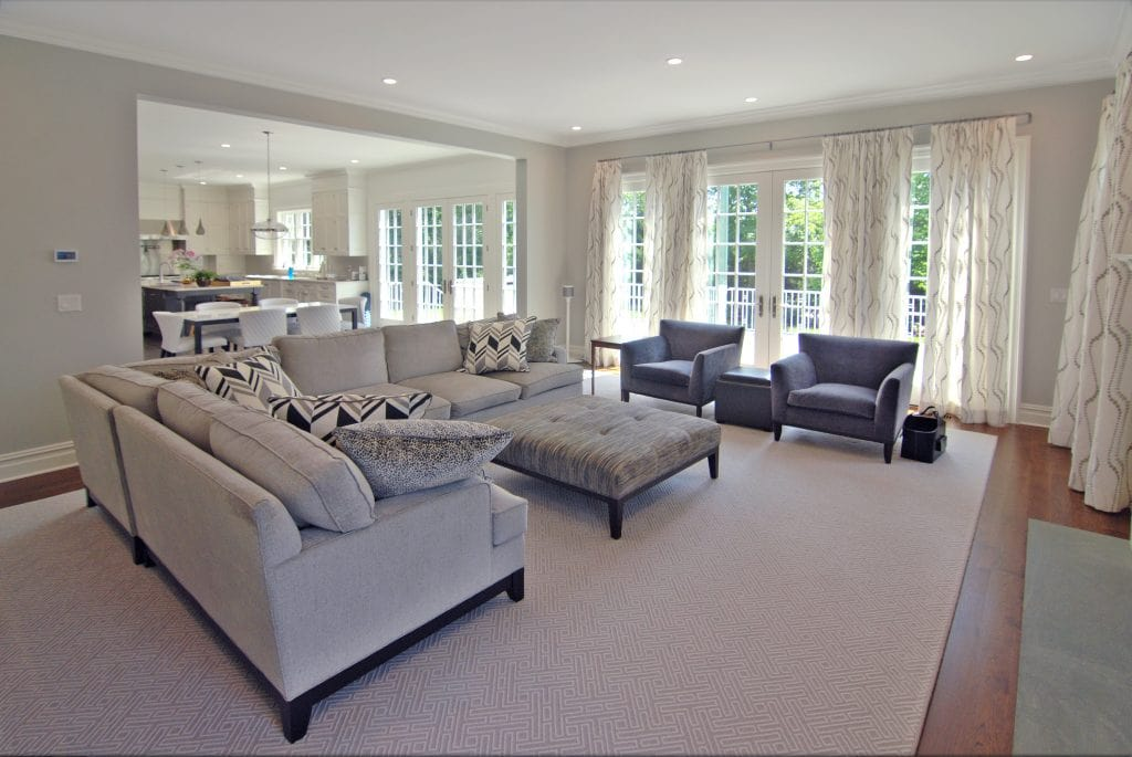 Family room with natural light in Westchester County NY by DeMotte Architects