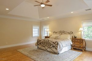 Master bedroom in Greenwich CT custom home by DeMotte Architects