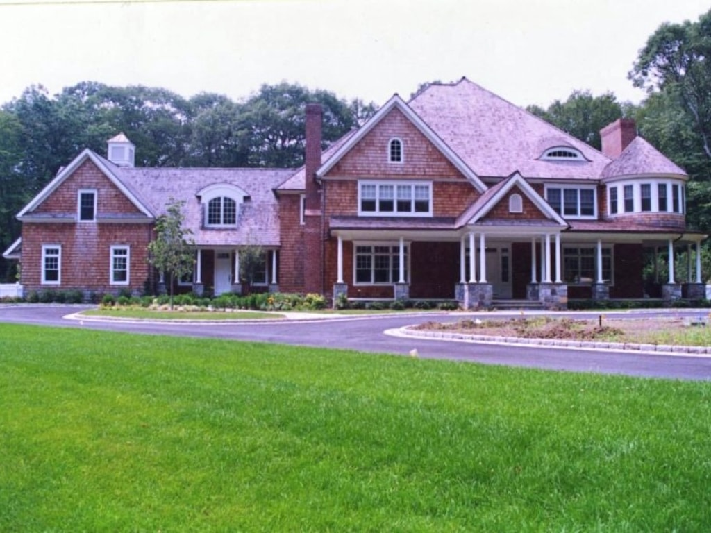 Shingle style home design by DeMotte Architects front of home shown in Pound Ridge NY