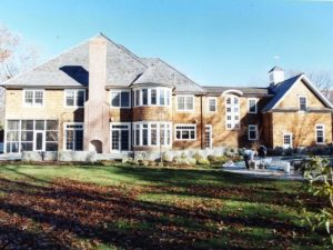 Shingle style home design by DeMotte Architects rear of home shown