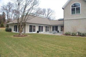 Shingle style home in Westport CT rear shown