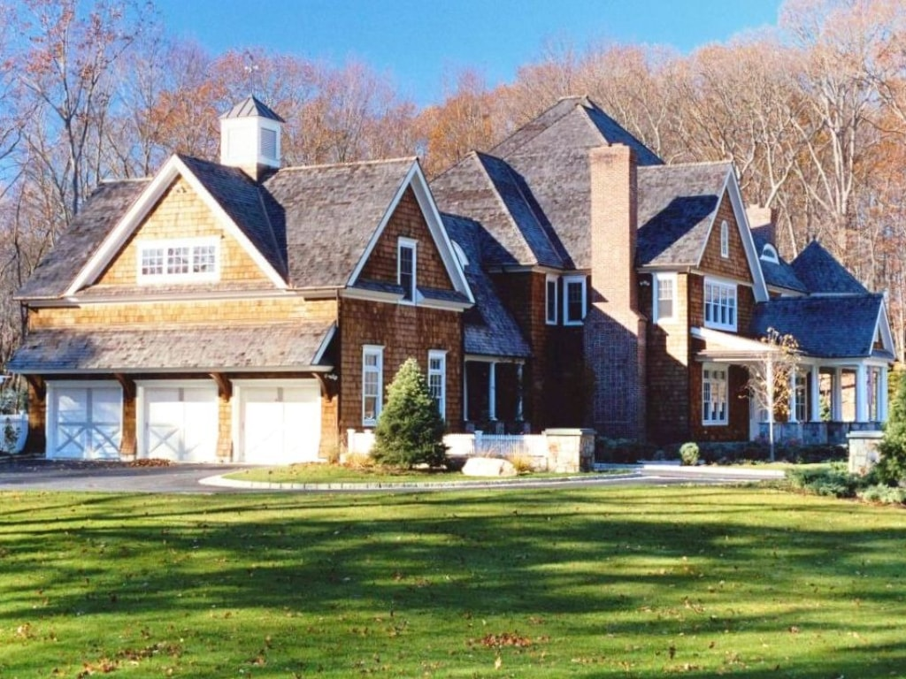 Shingle style home with 3 car garage home design by DeMotte Architects in NY