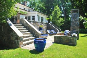 Westchester County NY home design with terrace and outdoor fireplace
