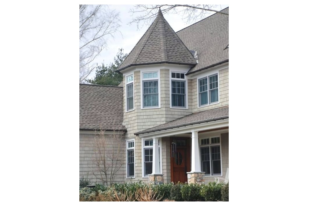 Westport CT shingle style home with turret entry by DeMotte Architects