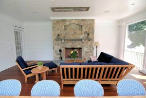 Westport CT home with fireplace in screened porch