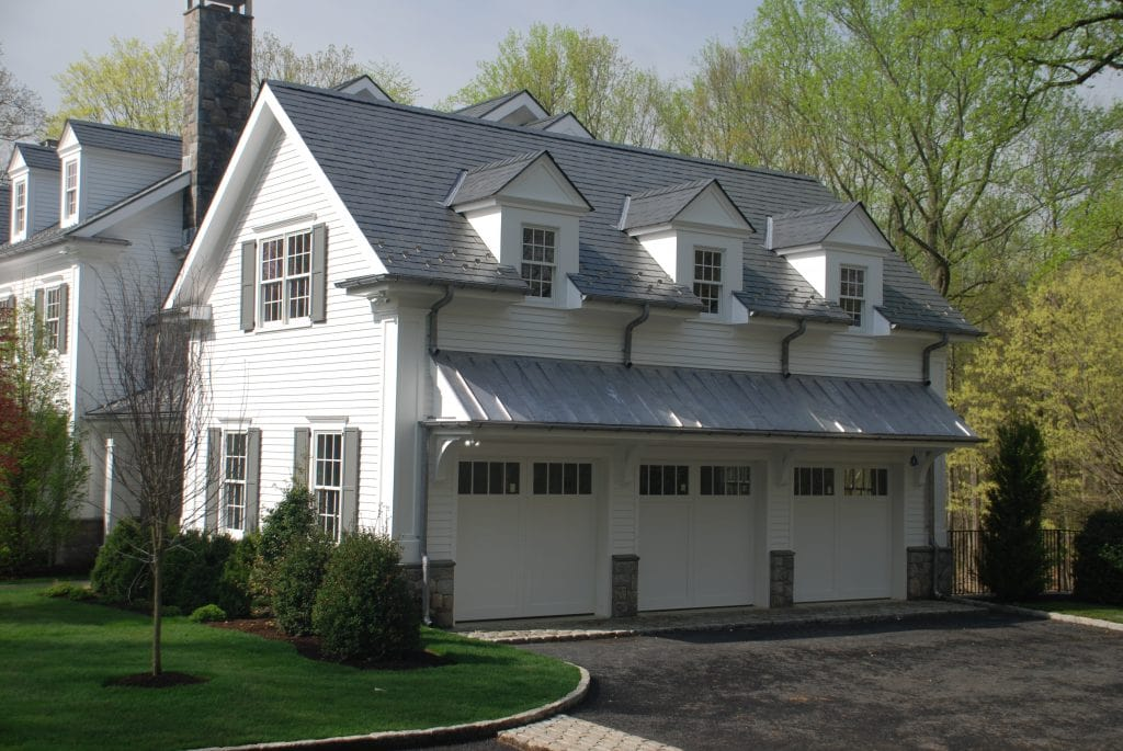 Greenwich Colonial home with 3 car garage by DeMotte Architects