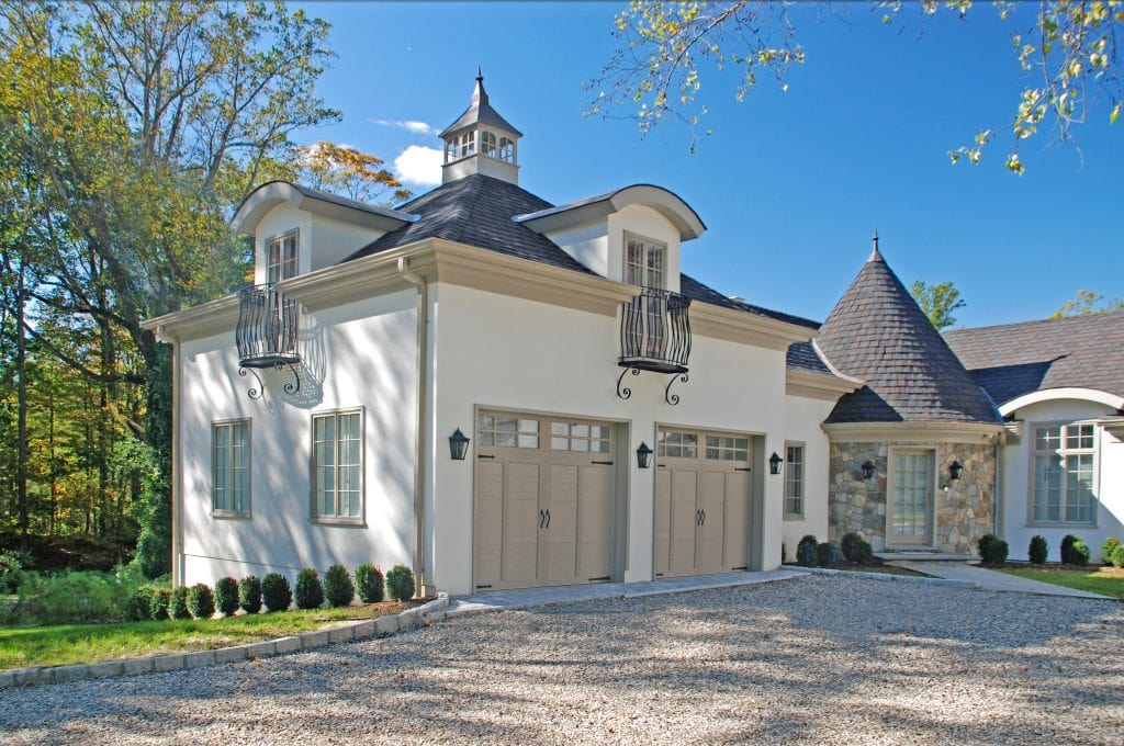 European style home with garage in Greenwich CT by DeMotte Architects