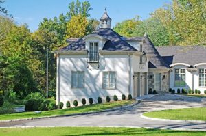 Greenwich CT home design with turret mud room entry by DeMotte Architects