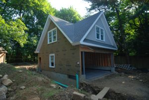 a shingle style garage being built in riverside ct