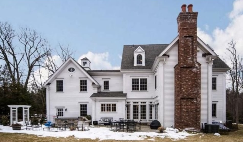 New Canaan CT home by DeMotte Architects rear shown