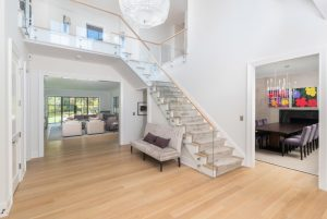 Contemporary foyer in Greenwich CT modern farmhouse by DeMotte Architects